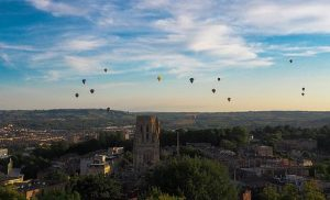 University of Bristol Wills building with hot air balloons in the sky