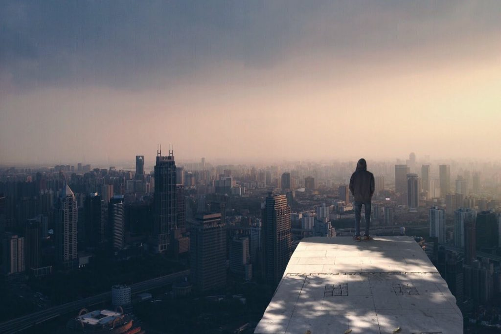 Man alone facing skyline