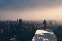 Man alone facing skyline