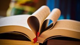 Heart shaped pages in a book- link to ESRC Funded Studentships page