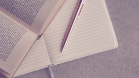Book and pen- link to how to apply? page