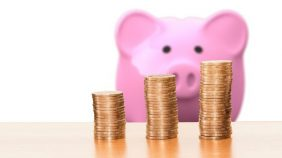 Piggy bank with coins- Link to Who is eligible for an ESRC funded studentship? page
