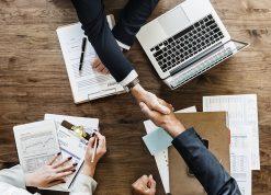 Business Meeting Statistics and Handshake